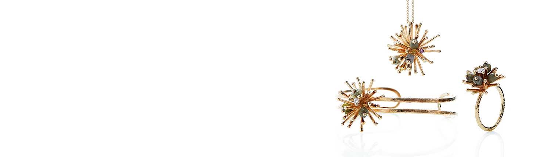 Smukke smykker i serien SPUTNIK med rå diamanter og mindre diamanter i brilliantslibning.